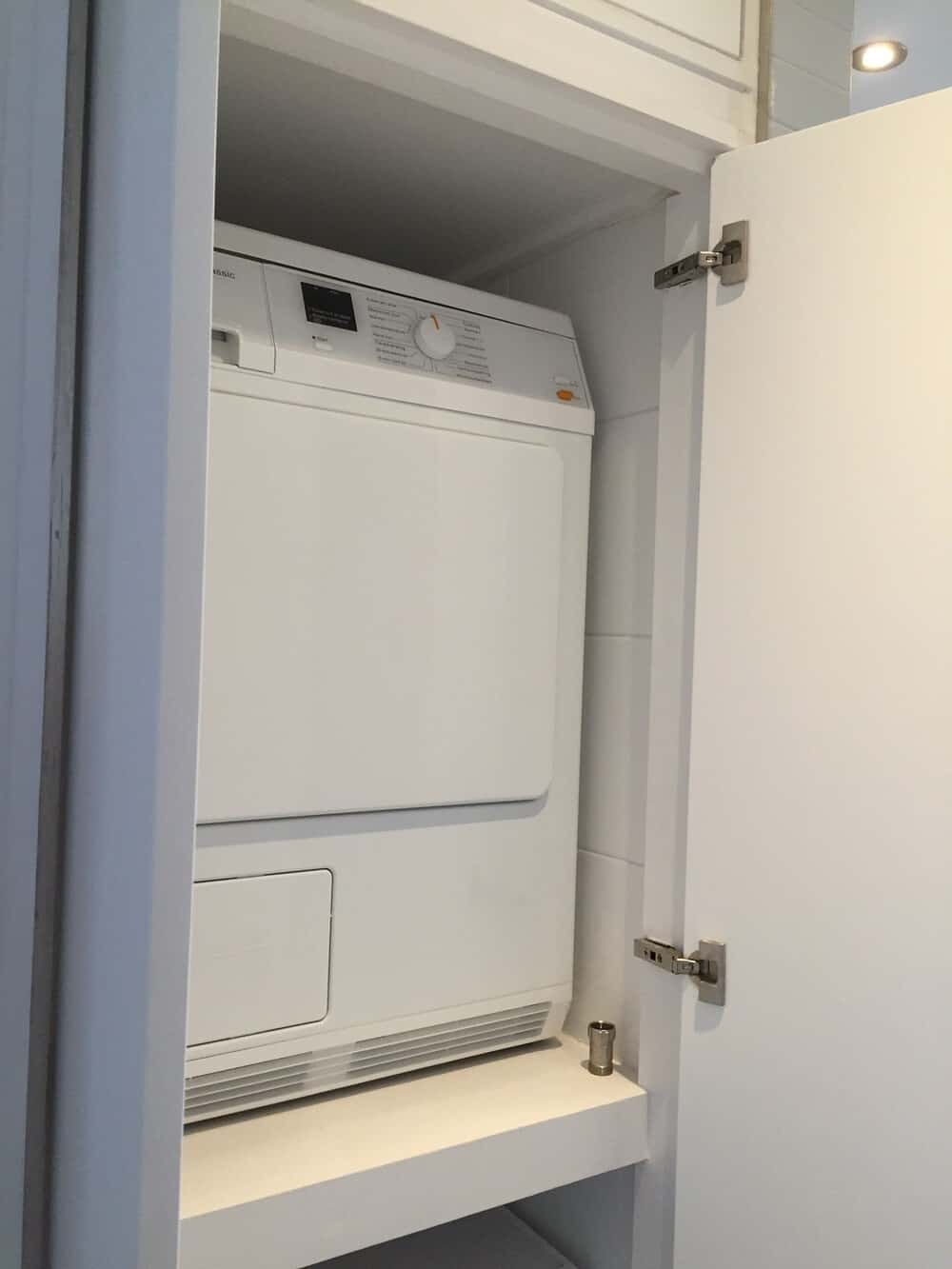 washer dryer in a closet
