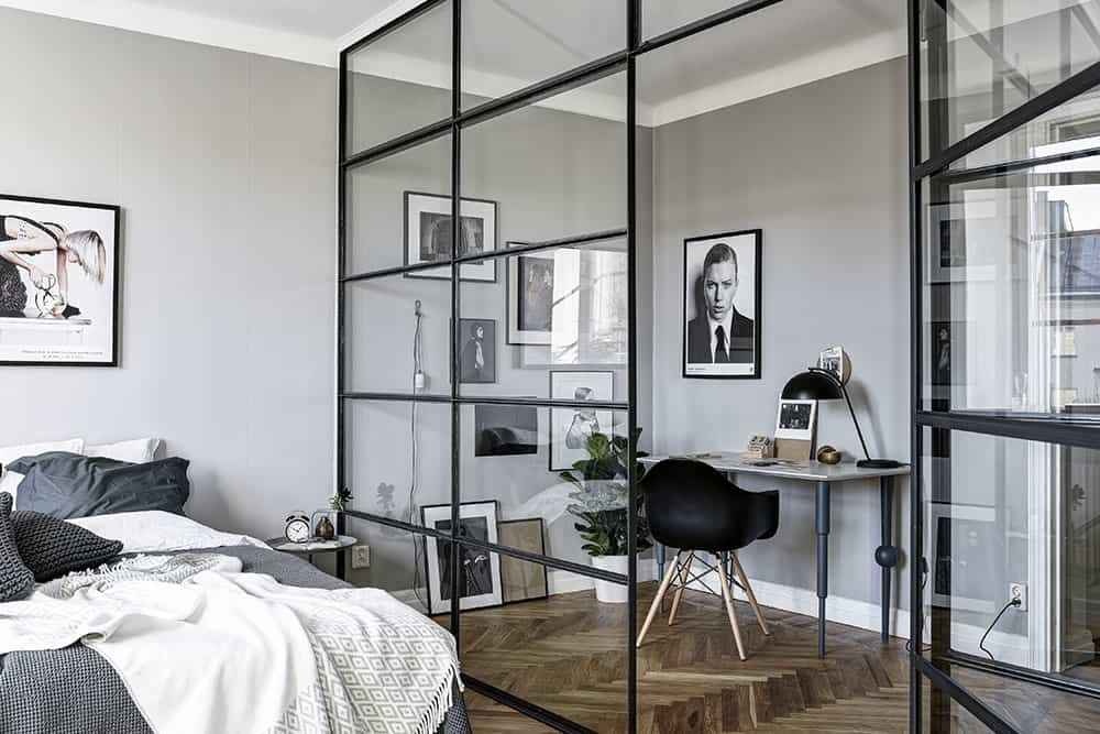 Crittall internal wall divides a bedroom and a home office