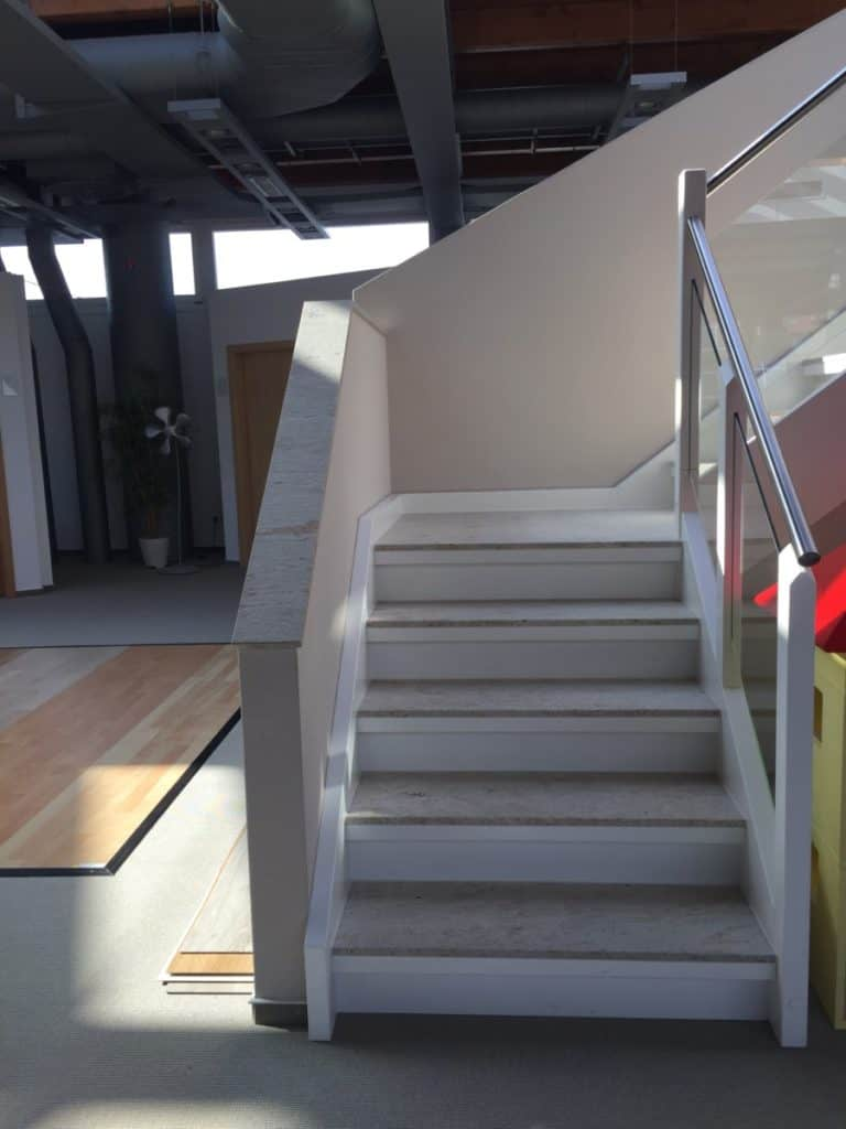 A White Corian Staircase style | stair materials | modern stair banister ideas | wood and glass staircase