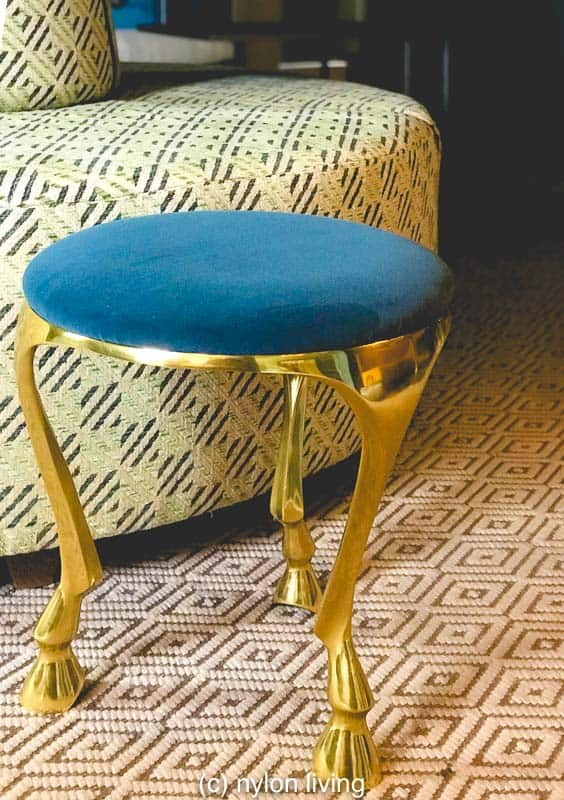 I love this side table with its fun hoofed feet.