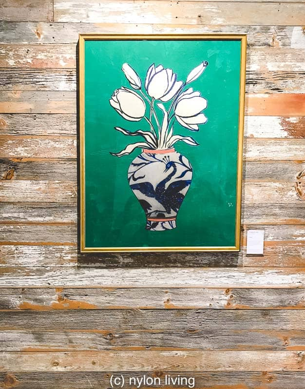 A vibrant green print against a weathered board background at Anthropologie Regents Street