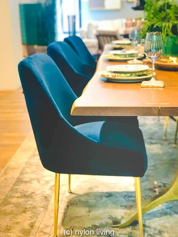 Velvet chairs with gold legs make you want to sit and stay a while.