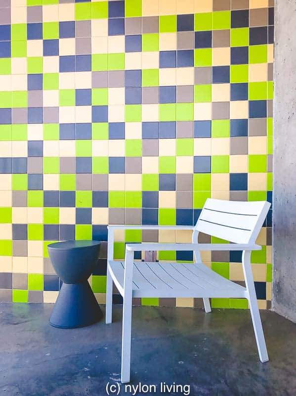 Lots of bright green which is toned down with the judicious of neutrals on the hotel patio