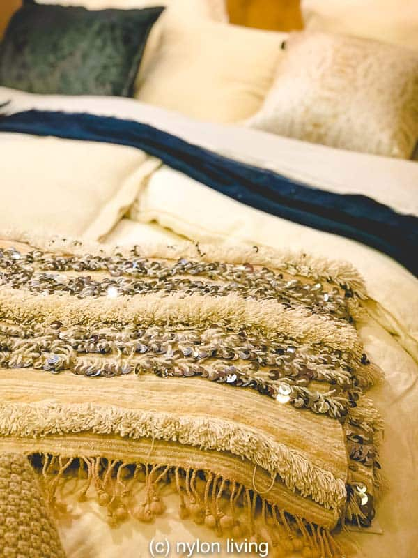 Luxe boho chic in the bedroom with a Handira wedding blanket used as a throw