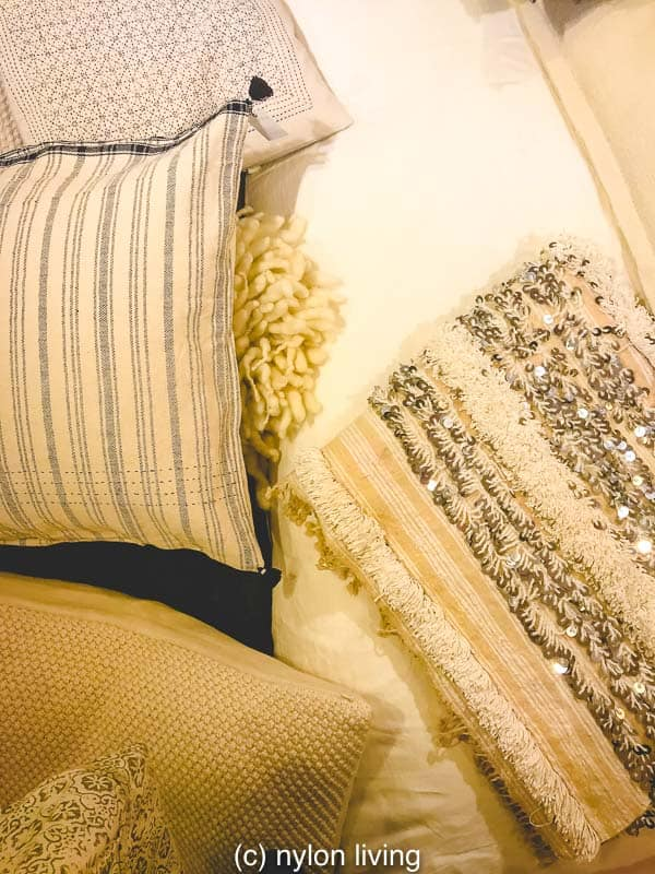 A wedding blanket Moroccan blends well with its neutral color and pattern.