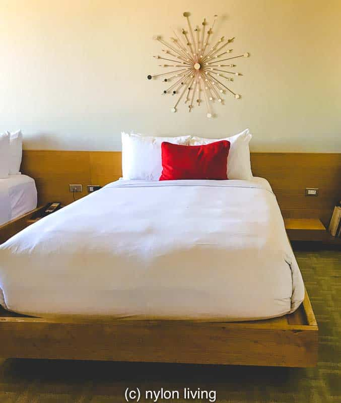 The headboards and night tables are built into the wall for the platform beds shows how function works with form