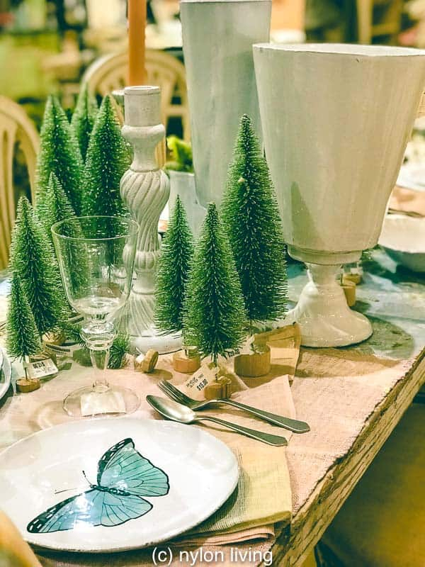 Instead of the usual floral centrepiece, sprinkle a few small Christmas tree ornaments on the table.