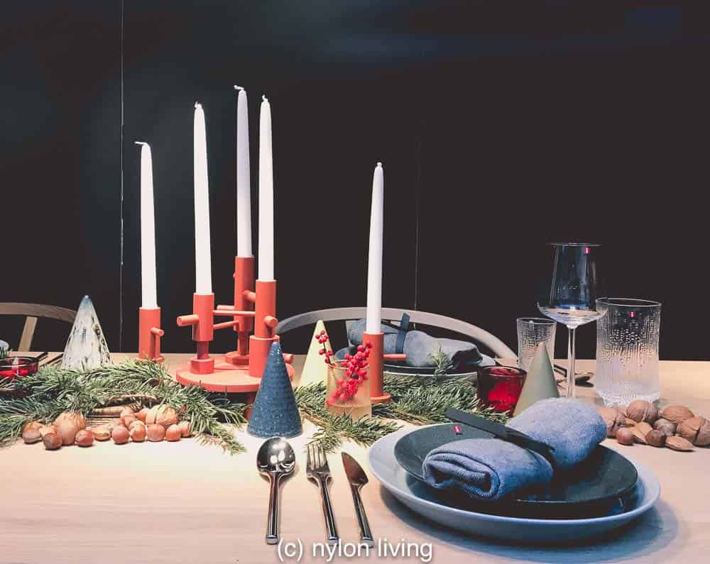A Scandinavian Christmas table really pops against dark walls.