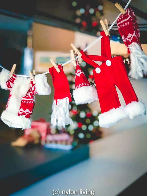 Nordic decorations for Christmas at our home include this charming washing line of Santa's clothes