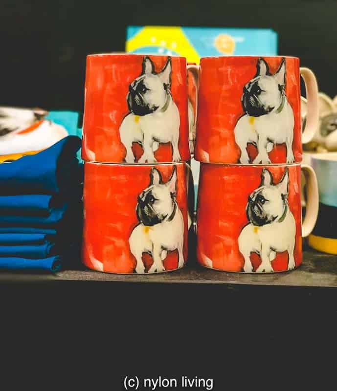 The graphic pattern of everyone's favourite trendy dog really pops in coral and grey on this cup.