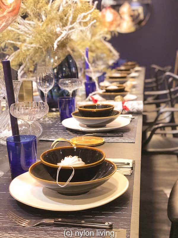 Elegant Christmas table settings showing off midnight blue Christmas decorations