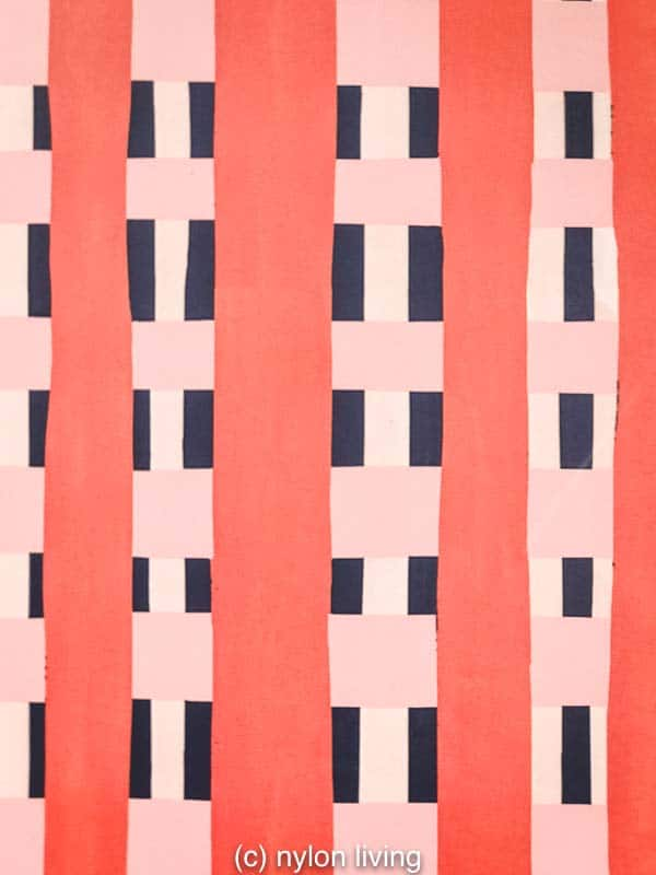 Coral and pink stripes create a soft yet graphic pattern