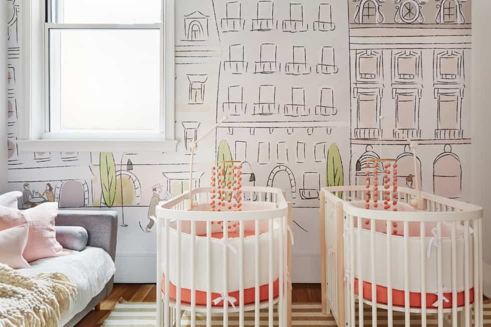 Coral nursery bedding for a shared twin girls' room