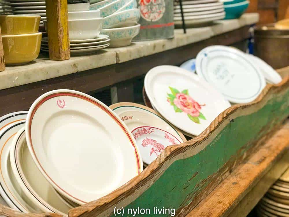 Fishs Eddy plates presented as a vintage treasure trove to rifle through.