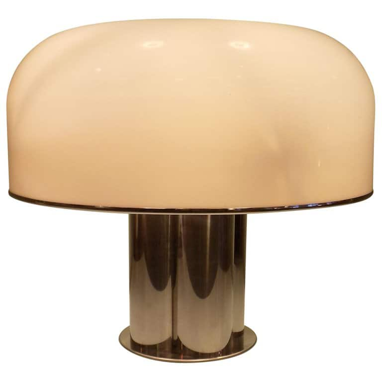 A Guzzini table lamp in white acrylic and chrome.