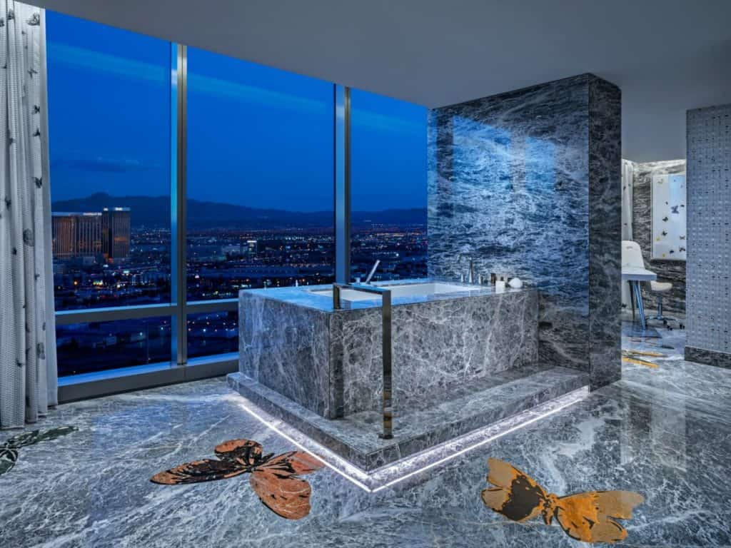 Now that's a soak with a view! And, check out the Hirst butterflies on the floor.