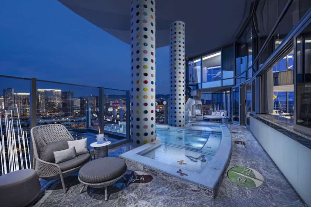 Damien Hirst Spots on the Fantasy Tower pillars flanking the cantilevered pool
