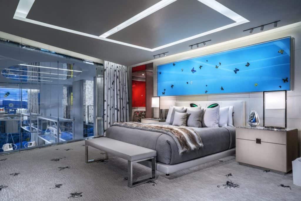 Glass walls on the bedrooms overlook the entertainment area below as well as the Vegas skyline