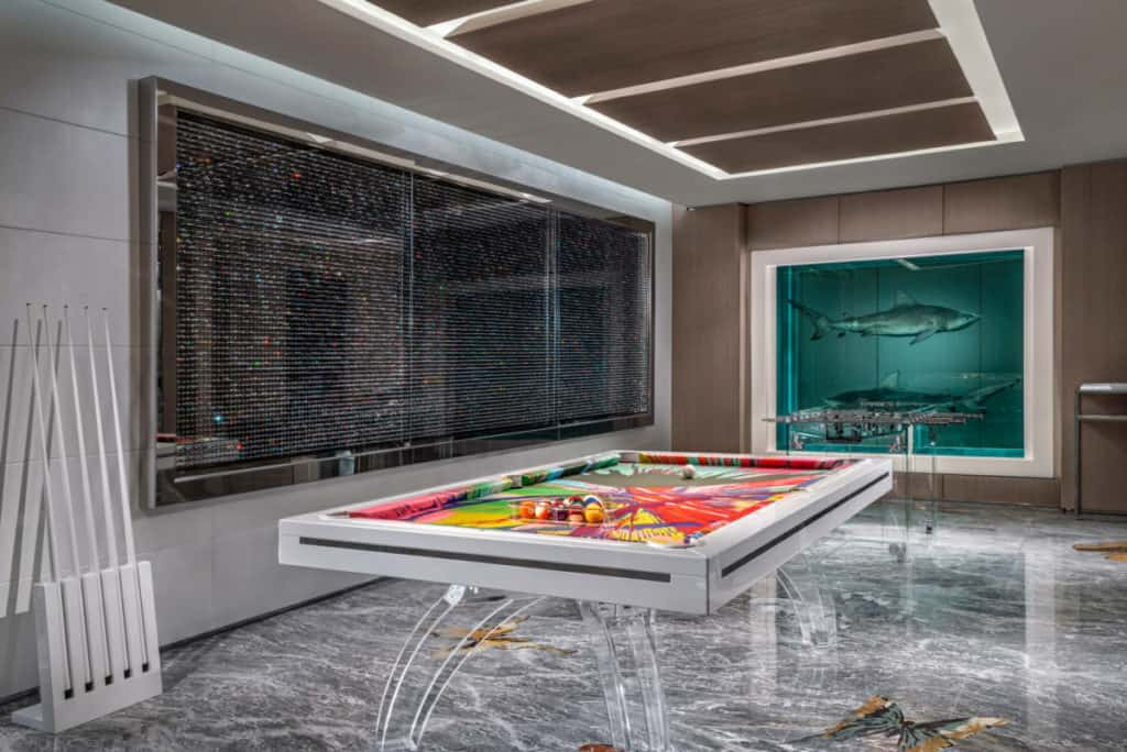 The games room in this Palms Casino suite has a table adorned with Hirst's spin painting.