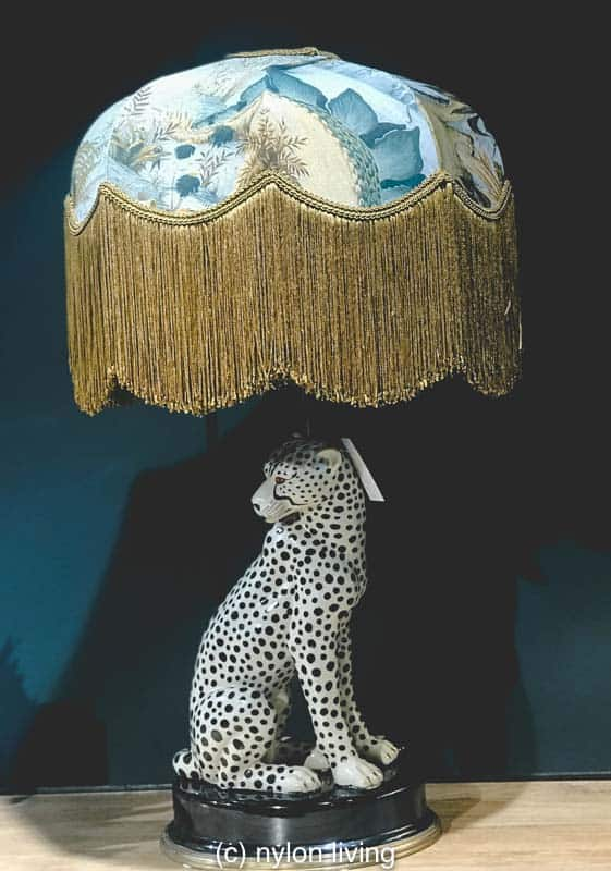 Aren't the fringed lamp shades table lamps set on animal bases charming?