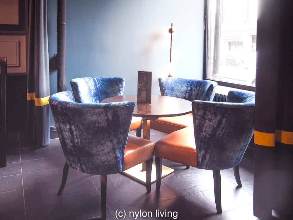 Midcentury modern furniture fits in with the trendy styling at the Malmaison Belfast Hotel