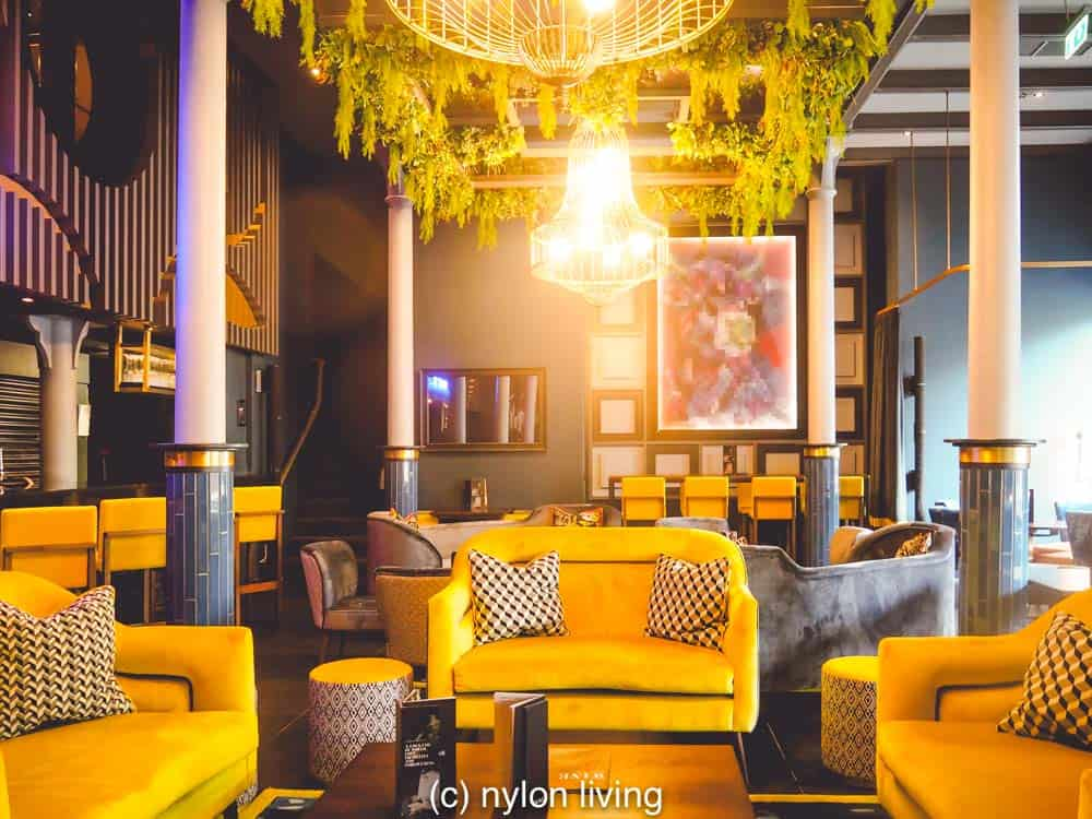 Gen Z yellow brightens up the bar and lounge.