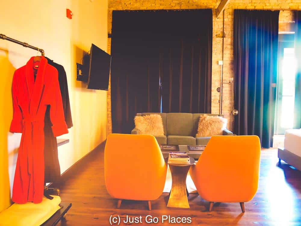 Wear your red robe and hang out in an orange chair for a 70's acid color trip.