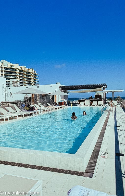 rooftop pool at Miami hotel with swimmers