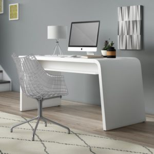 curved desk with computer and chair and rug