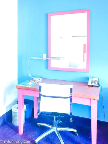 pink writing desk and mirror with a white chair