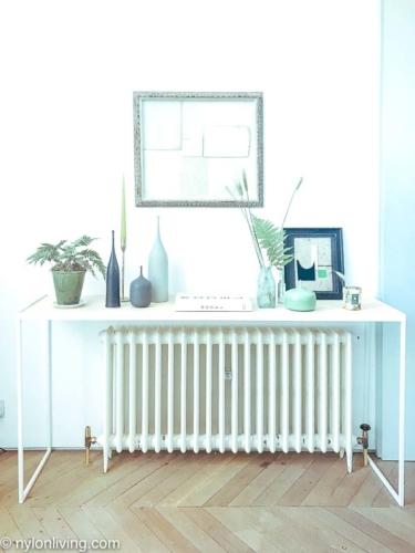 white writing desk over a radiator