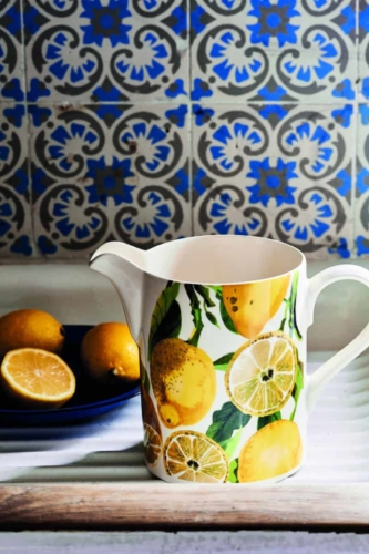 emma bridgewater lemon mug and blue background