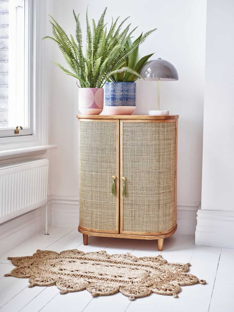 Jute mat, treno table lamp and Kinship rattan cabinet