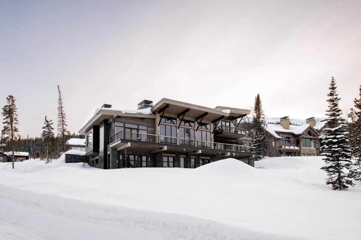 modern ski house set in the snow at Yellowstone Club