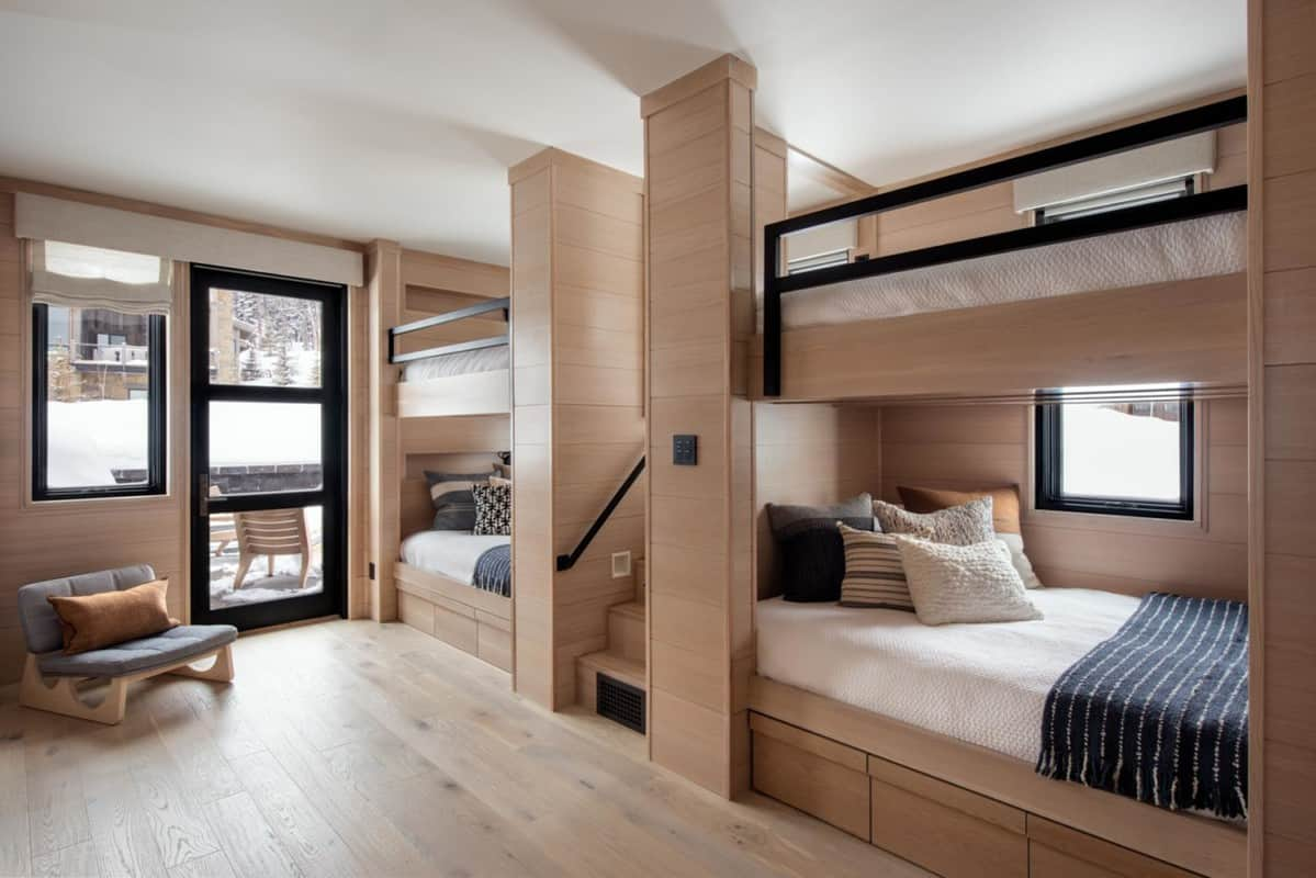 a modern bunk room with staircase at ski house in Yellowstone club residence