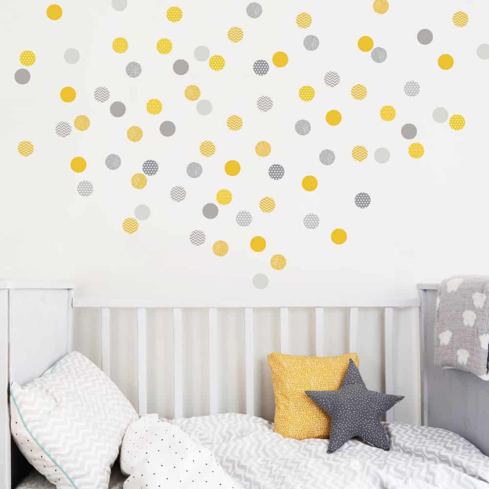 yellow and grey polka dots in a baby nursery